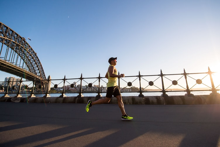 Man running with the help of peptide therapy
