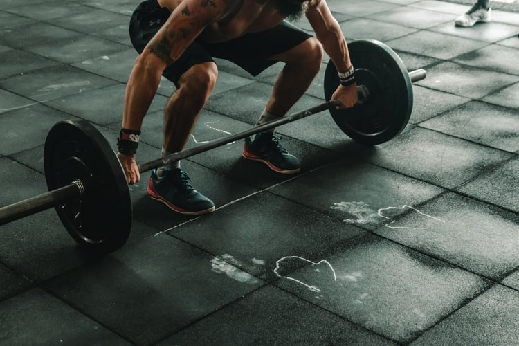 Man lifting weights support of elevated GH levels